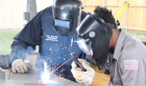 LSCO welding student and instructor